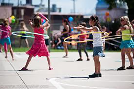 Kids playing with hula hoops