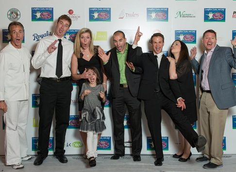People at an event making silly faces for the camera